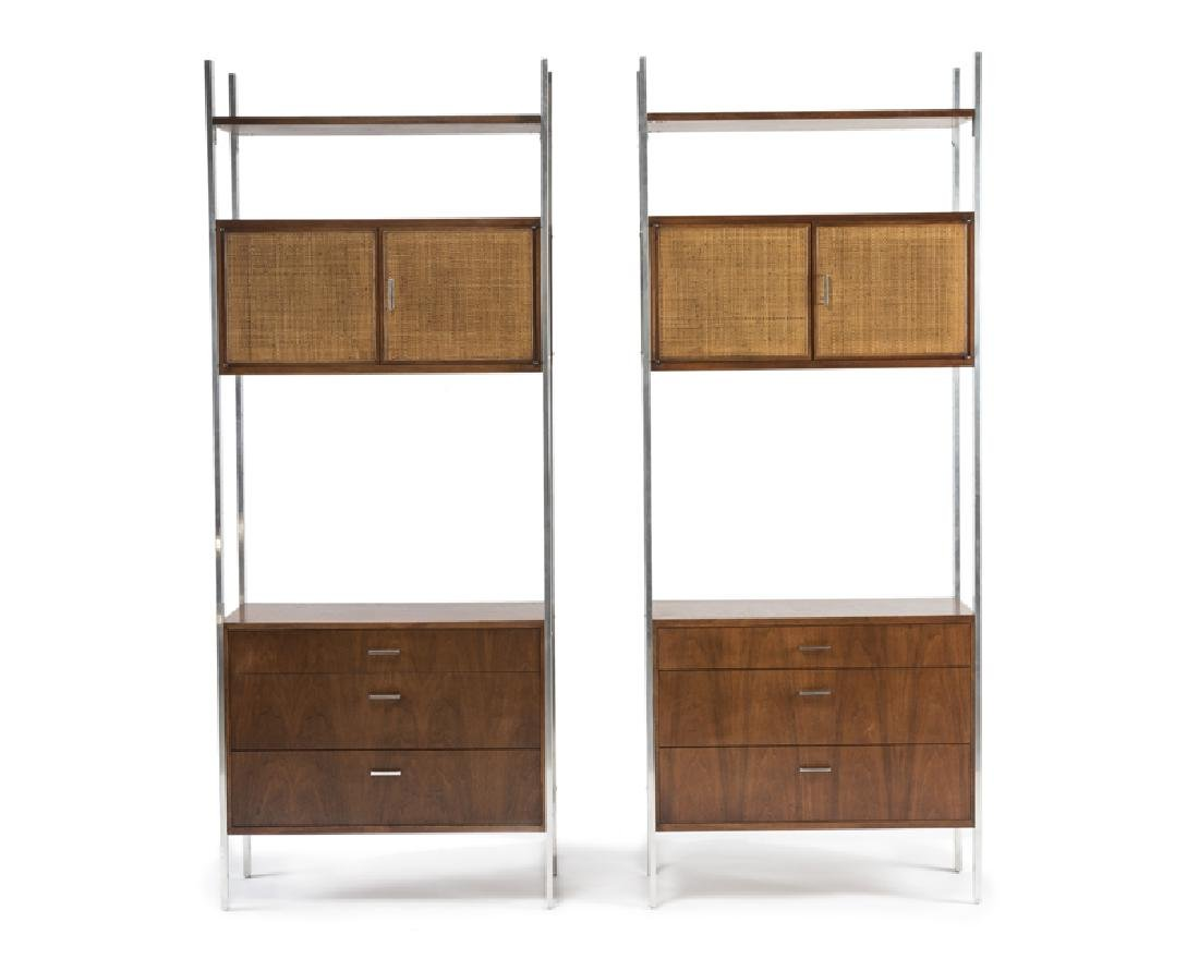 A pair of teak shelf units