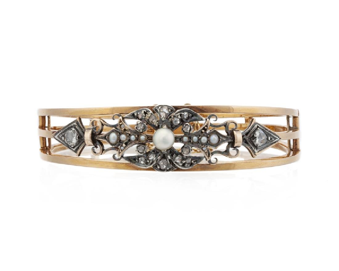 A Victorian pearl and diamond hinged bangle bracelet