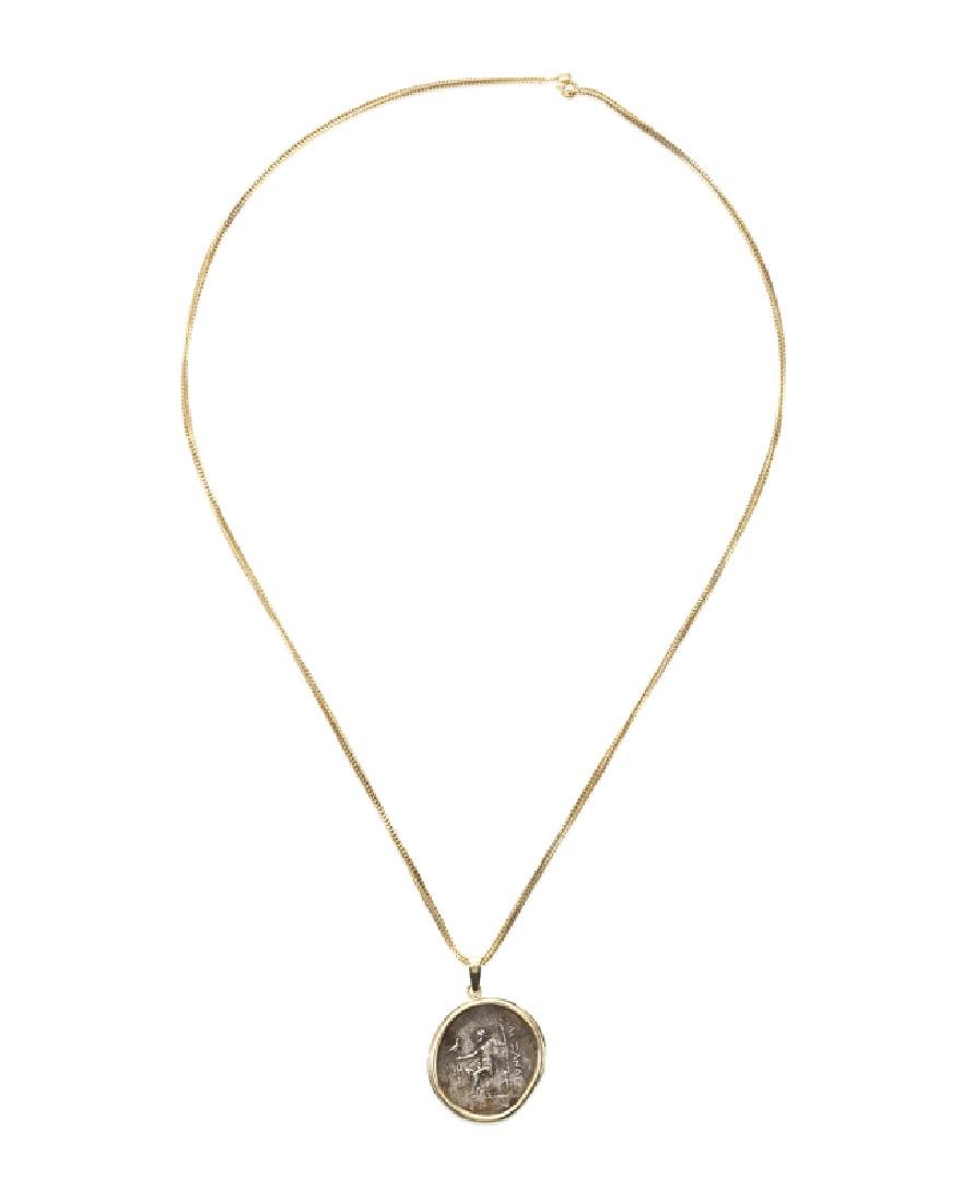 A gold and metal coin necklace