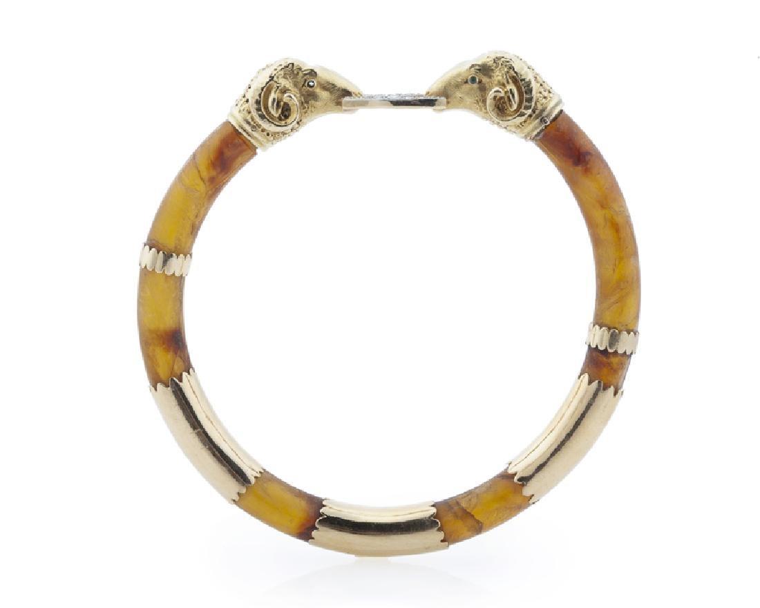 An amber and diamond ram's head bangle