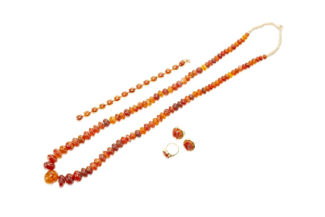 A group of carnelian jewelry, including GUMPS