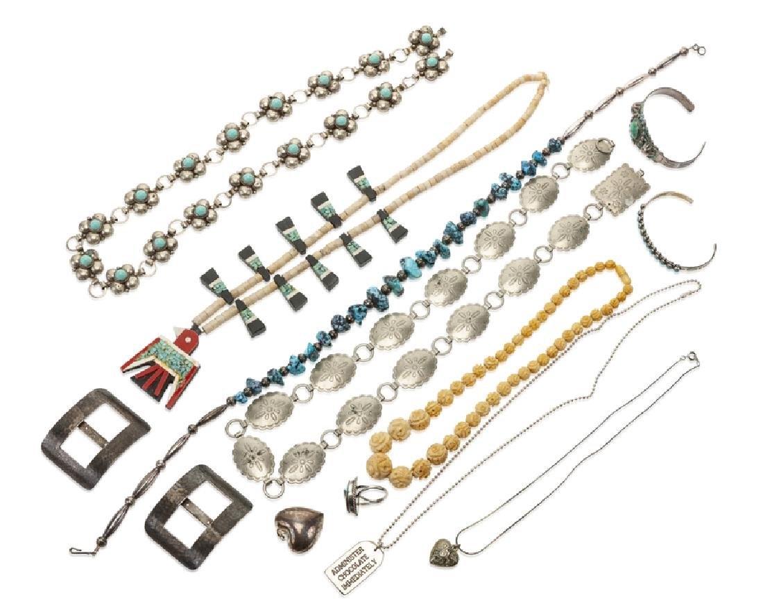 A group of silver and metal jewelry