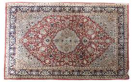 A Persian silk area rug