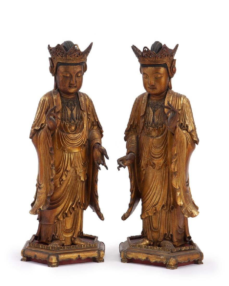 A pair of Chinese carved giltwood figures