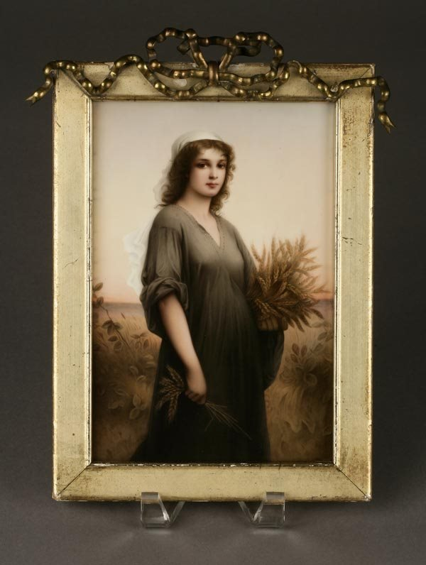 1002: A KPM PORCELAIN PLAQUE OF RUTH GLEANER WOMAN