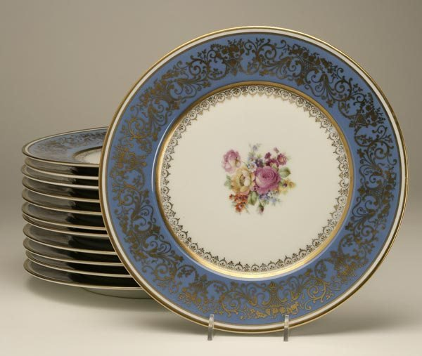 1009: TWELVE BOHEMIAN GILT AND FLORAL DECORATED PLATES
