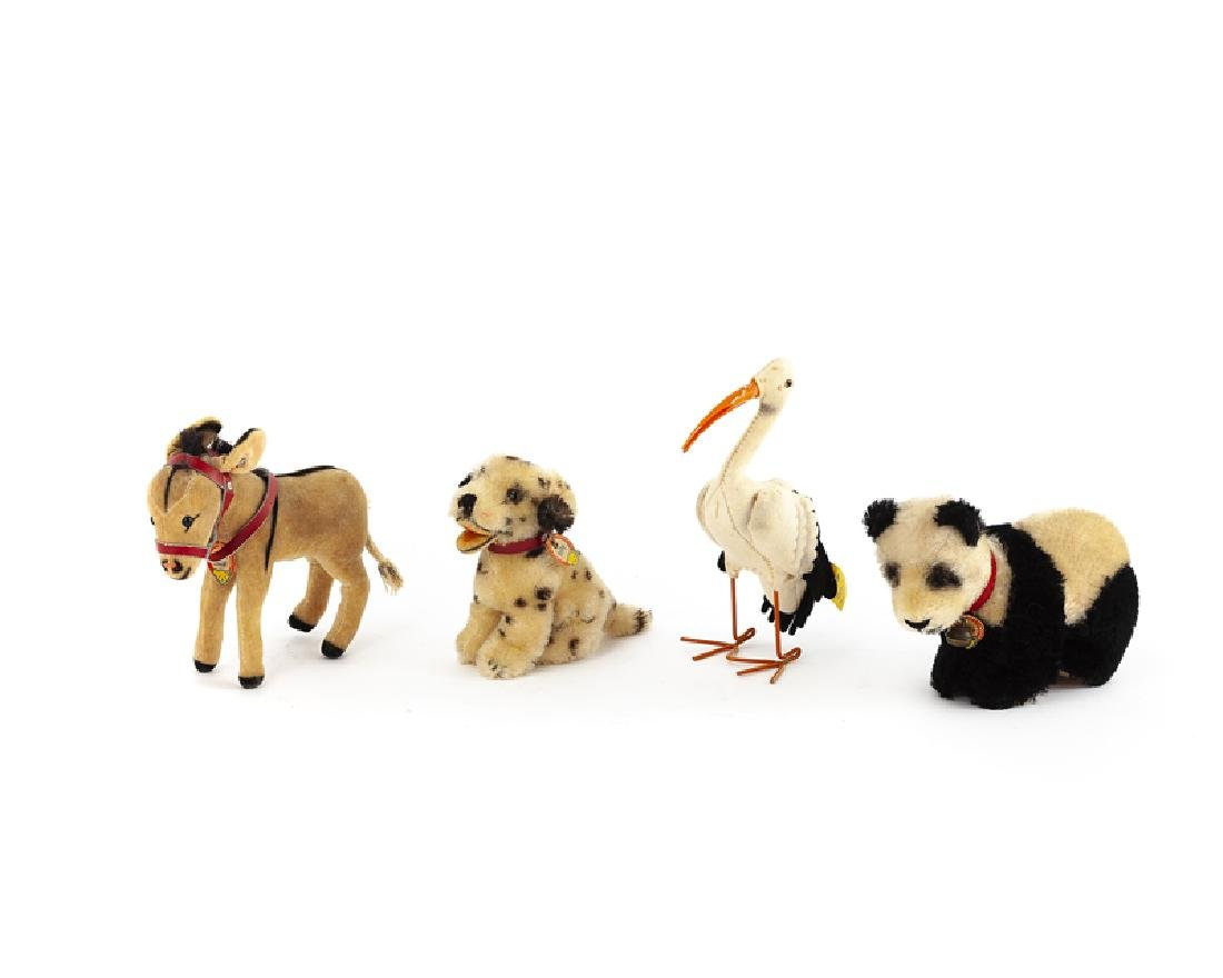 Four Steiff stuffed animals