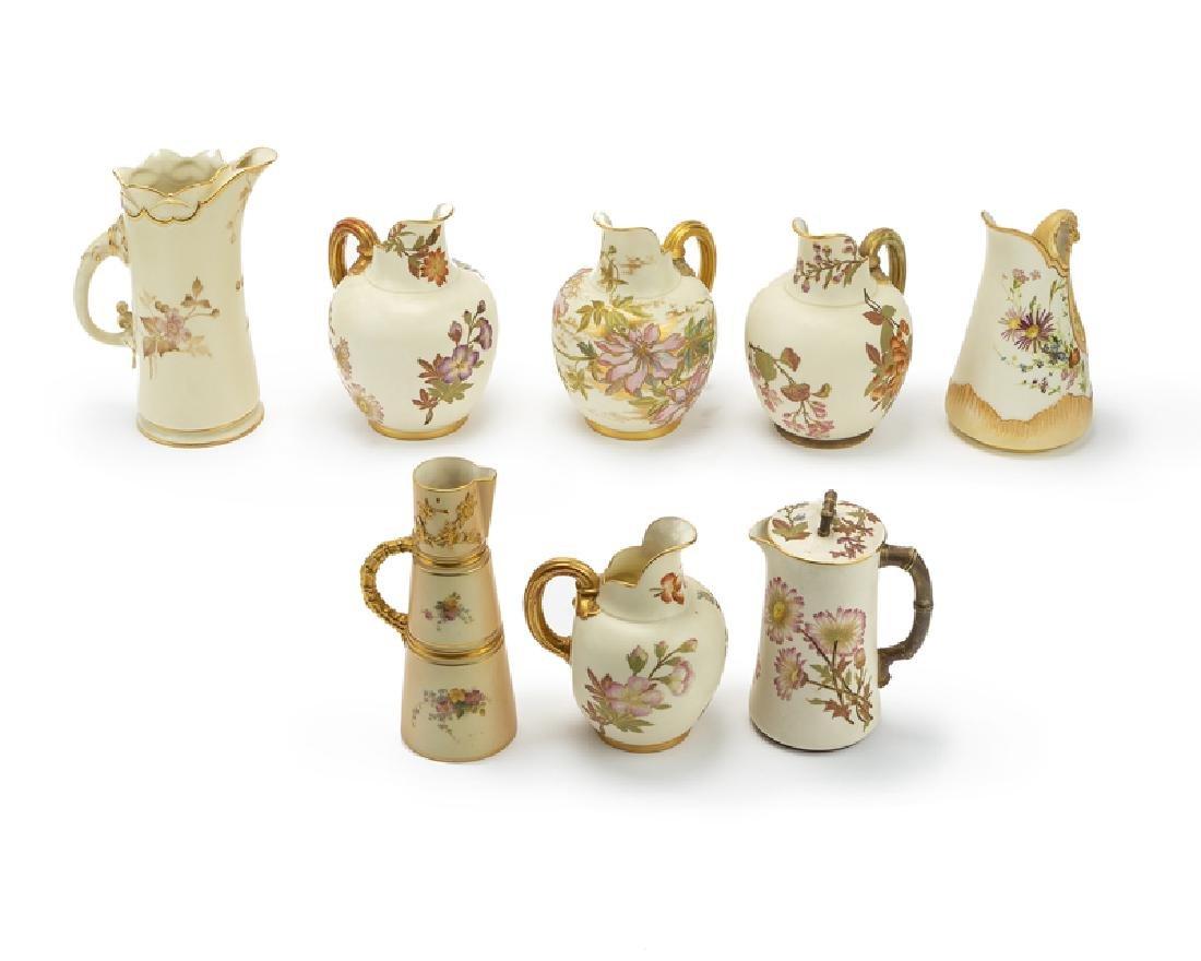 Eight Royal Worcester hand-painted pitchers