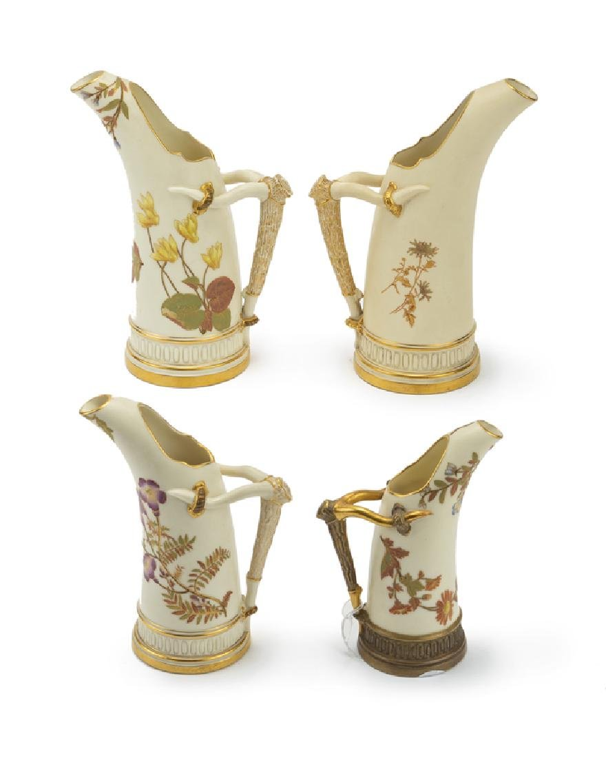 Four Royal Worcester hand-painted ''horn'' pitchers