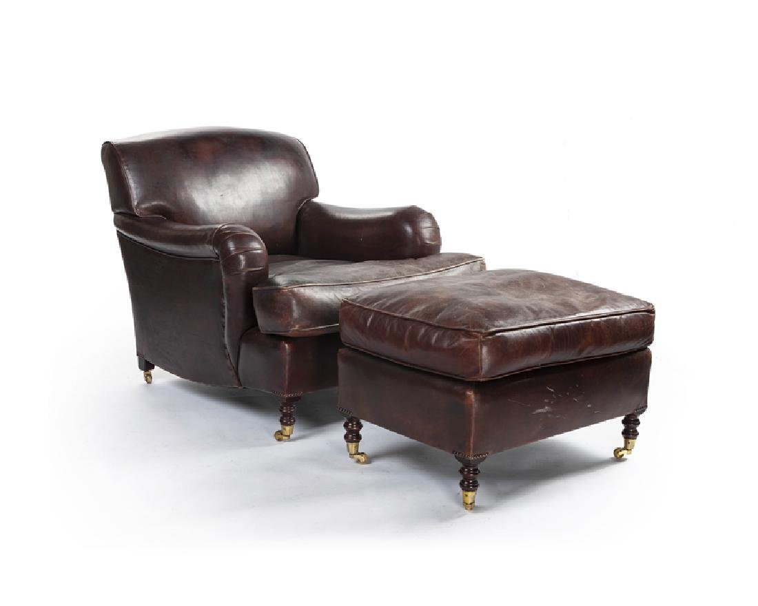 An Edwardian-style leather lounge chair and ottoman