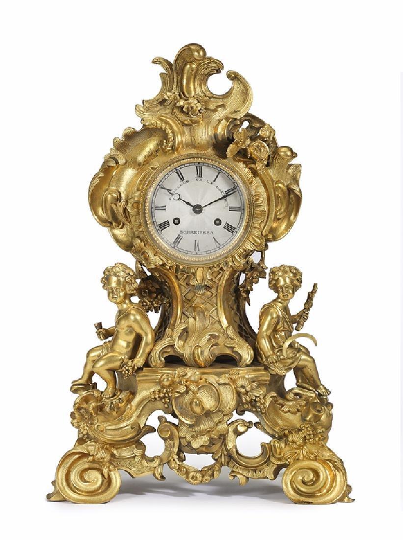 A Louis XV-style gilt-bronze mantel clock