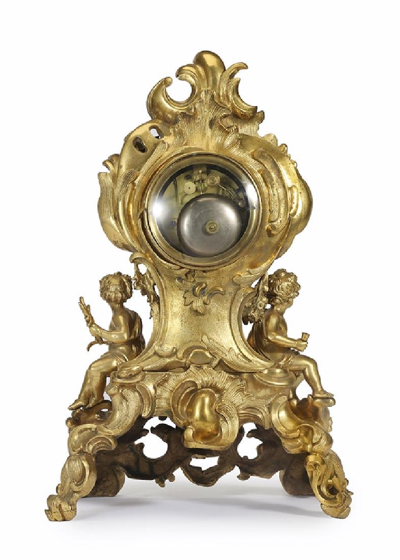 A Louis XV-style gilt-bronze mantel clock - 2