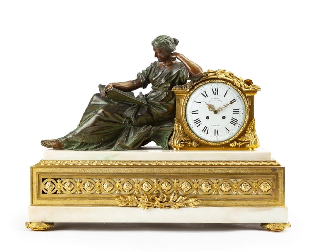 A French neoclassical-style gilt and patinated bronze