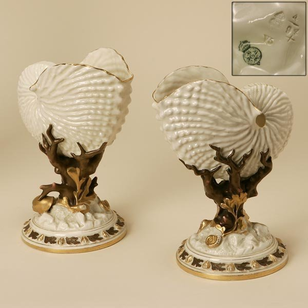 2019: A PAIR OF ROYAL WORCESTER NAUTILUS-FORM VASES