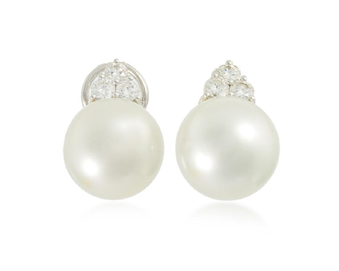 A pair of South Sea cultured pearl and diamond ear