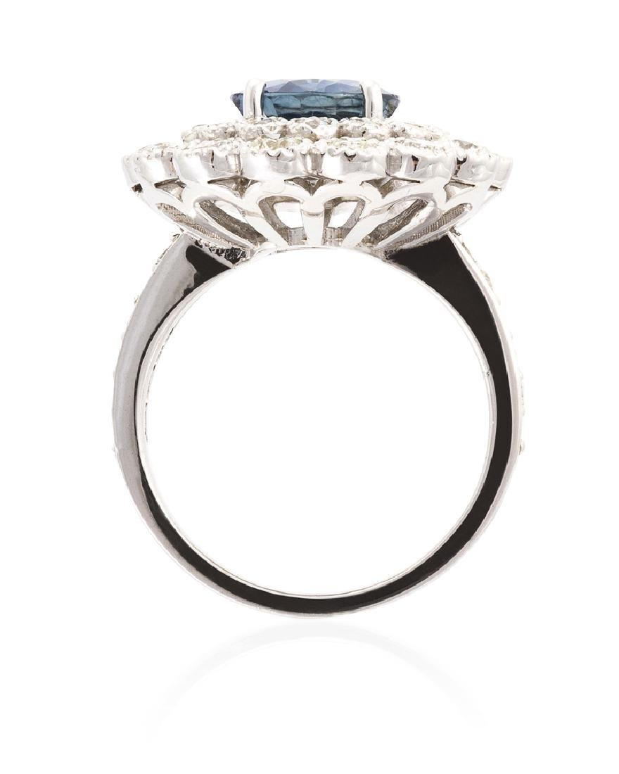 A sapphire and diamond ring - 4