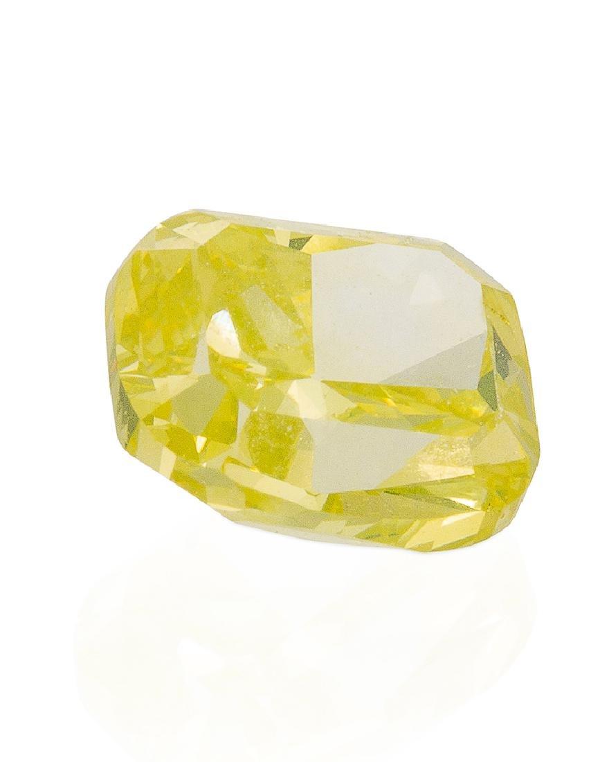 An unmounted natural fancy vivid greenish-yellow