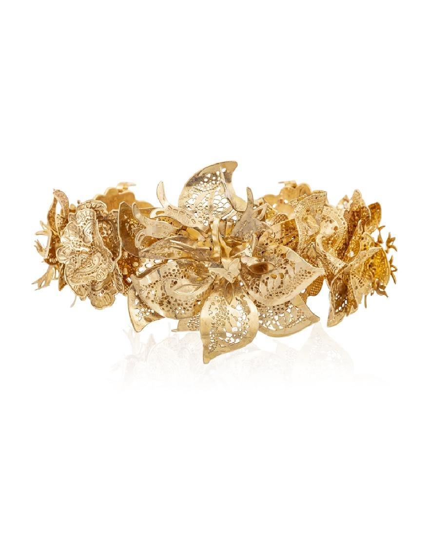 A gold flower cuff bracelet