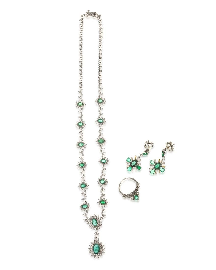 A group of emerald and diamond jewelry