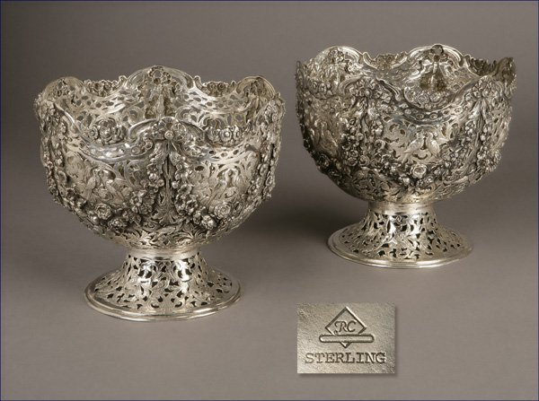 1003: Pair of cast sterling silver pierced footed bowls