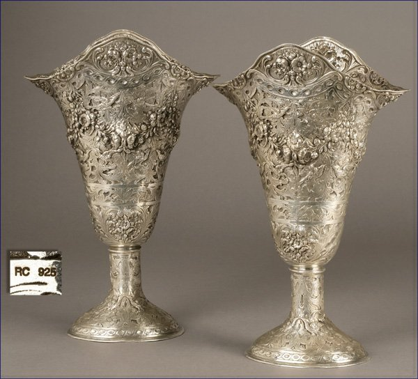 1004: A pair of cast sterling silver footed vases