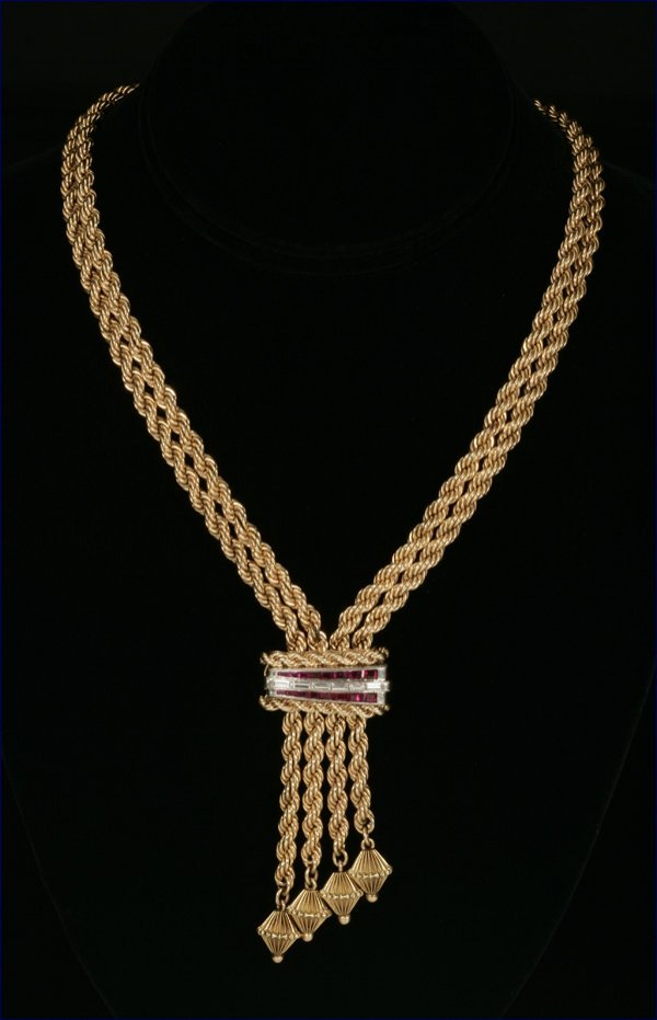 1018: A gold rope, ruby and diamond lariat necklace