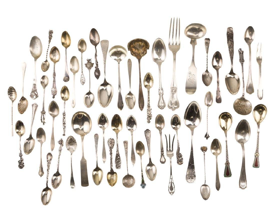 A group of silver flatware items
