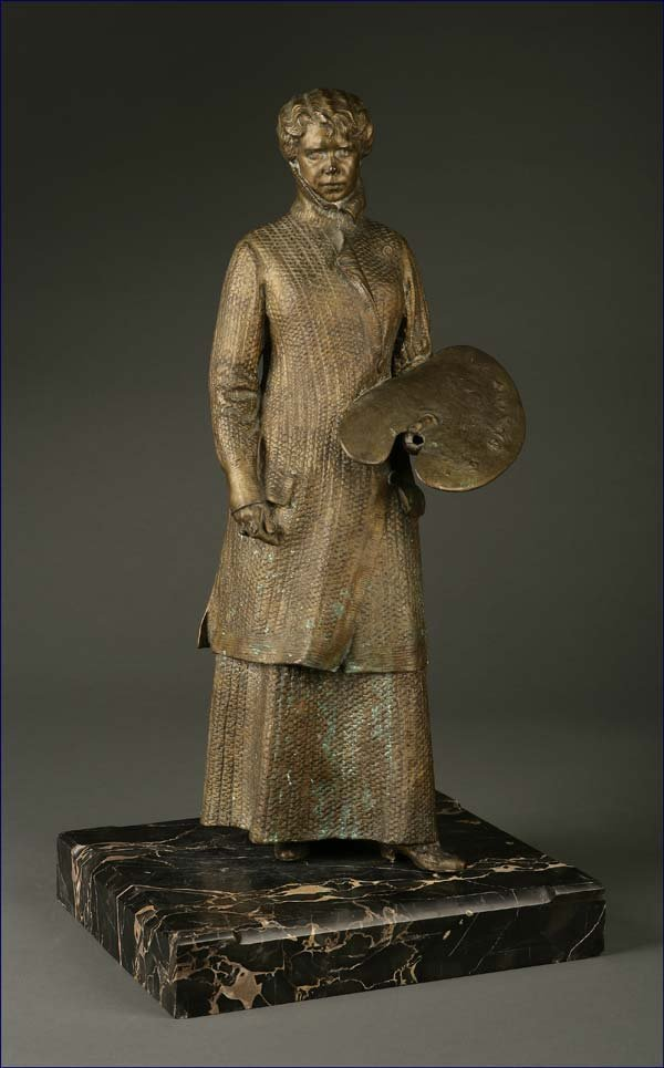 1013: A patinated bronze figure of a woman artist