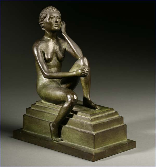 1015: A patinated bronze figure of a nude woman