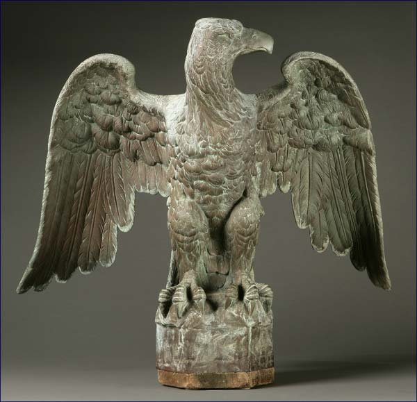 1017: A patinated bronze figure of an eagle