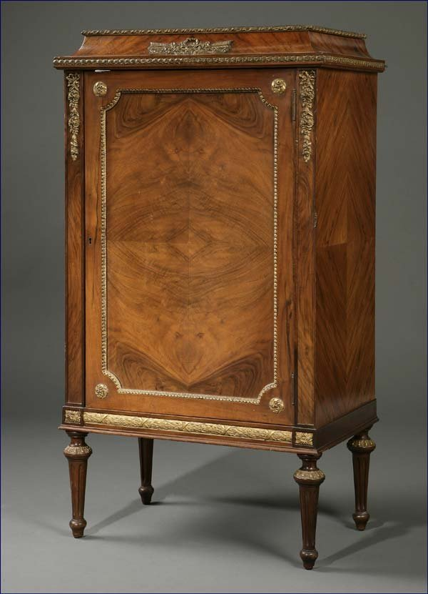 1024: Louis XVI style parcel-gilt walnut music cabinet