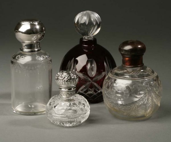 2004: A group of four glass silver perfume bottles