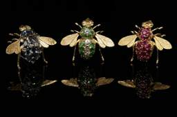 2230: Three gold and gemset bee brooches
