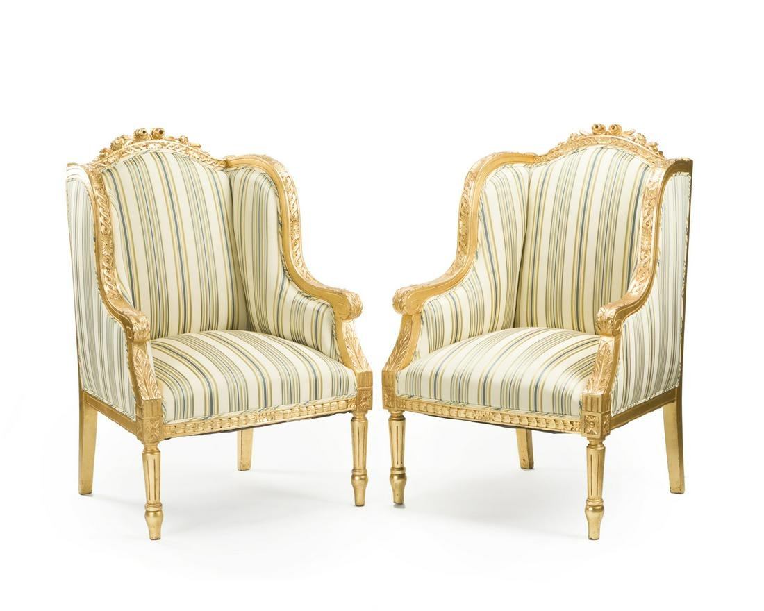 A pair of French Louis XV-style armchairs