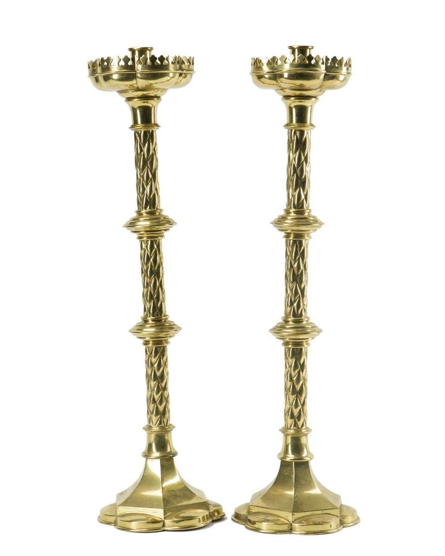 A pair of brass pricket sticks