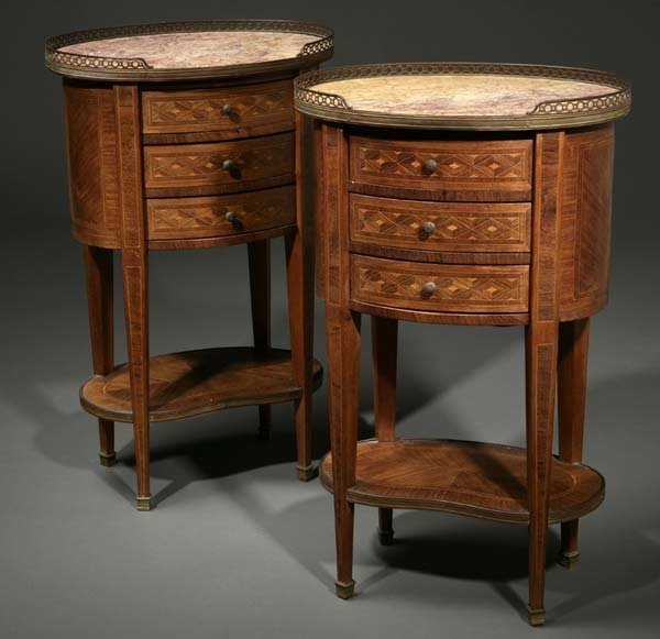 1008: A pair of Louis XVI style petit commodes