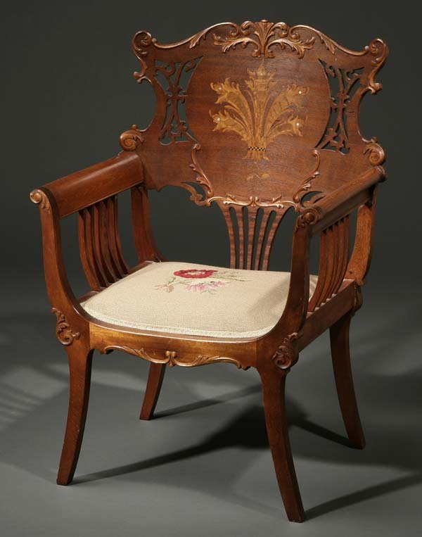 1019: Continental Rococo style inlaid mahogany armchair