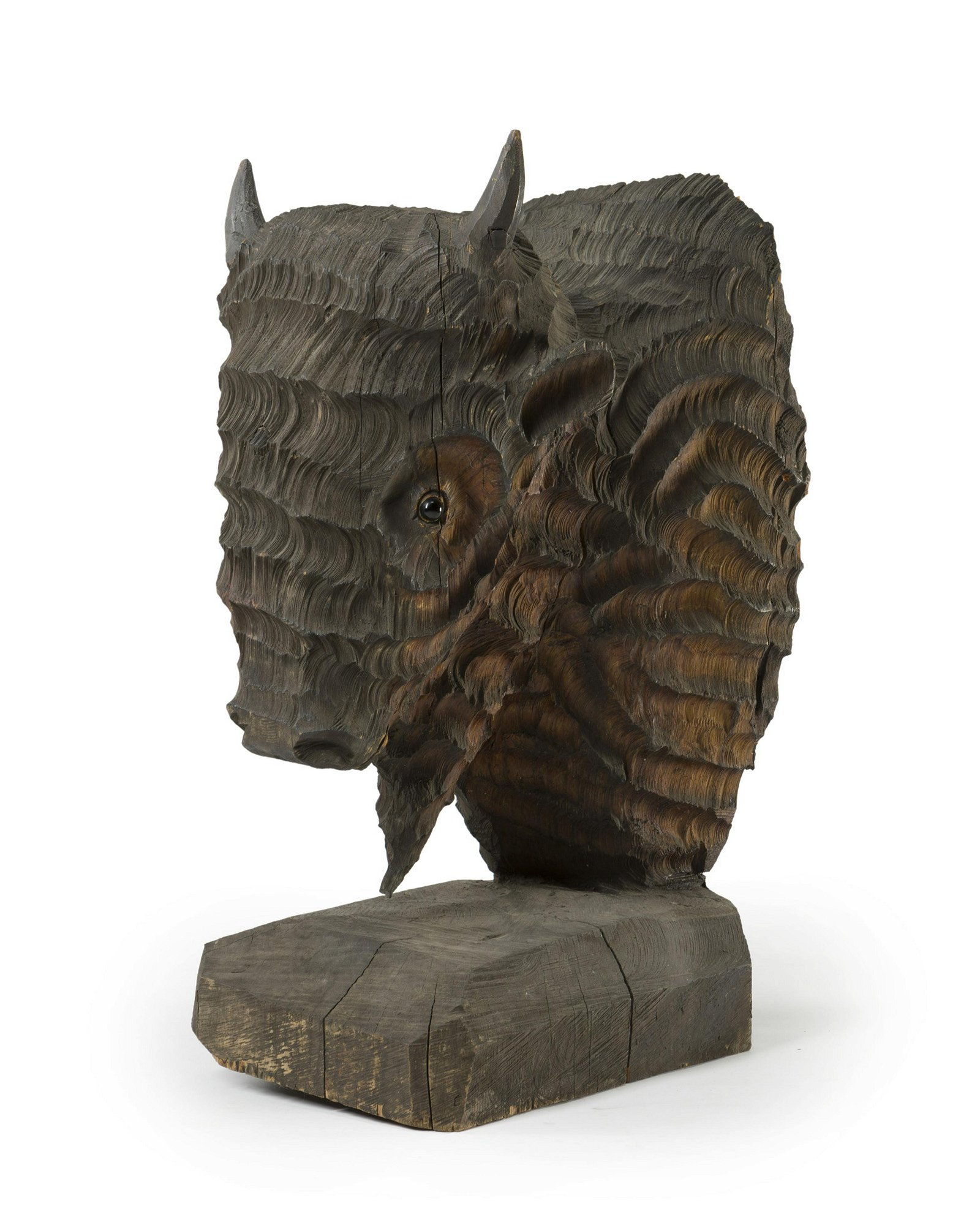 A chainsaw-carved wood bison head, Don Culp