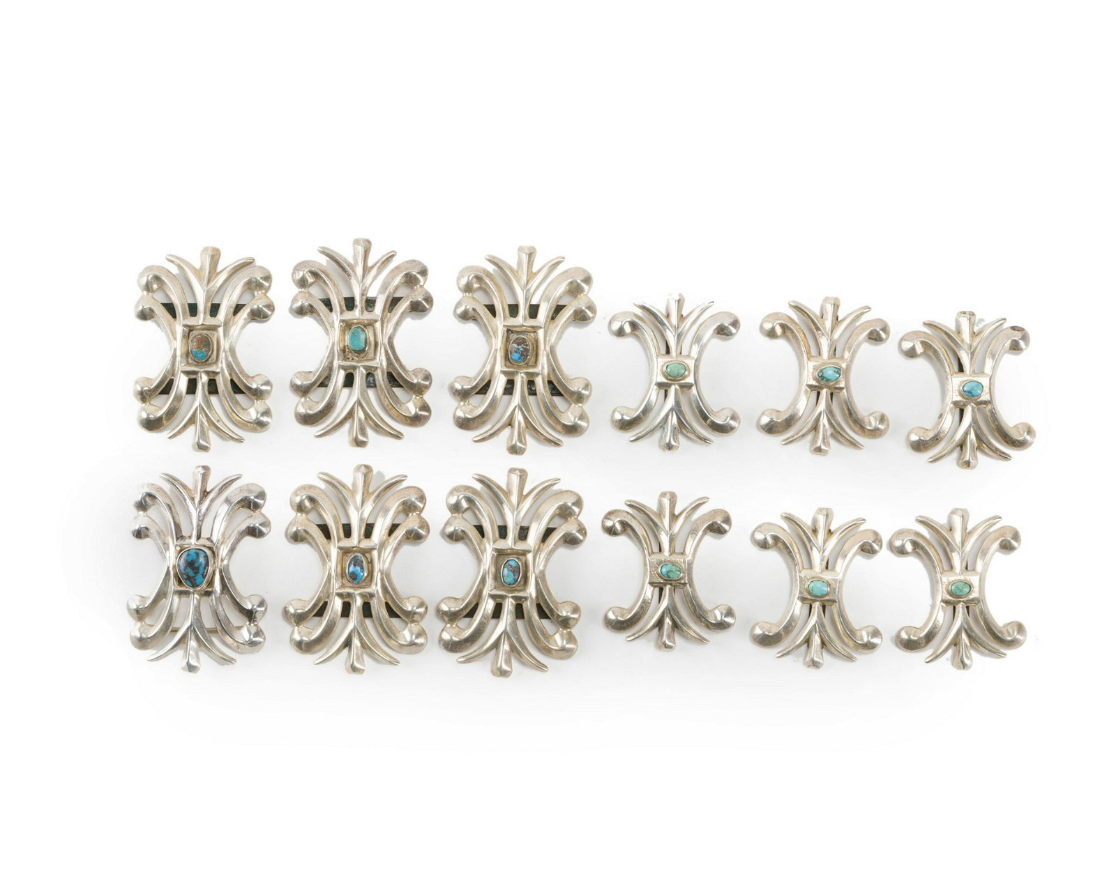 A set of sterling silver conchos and matching belt