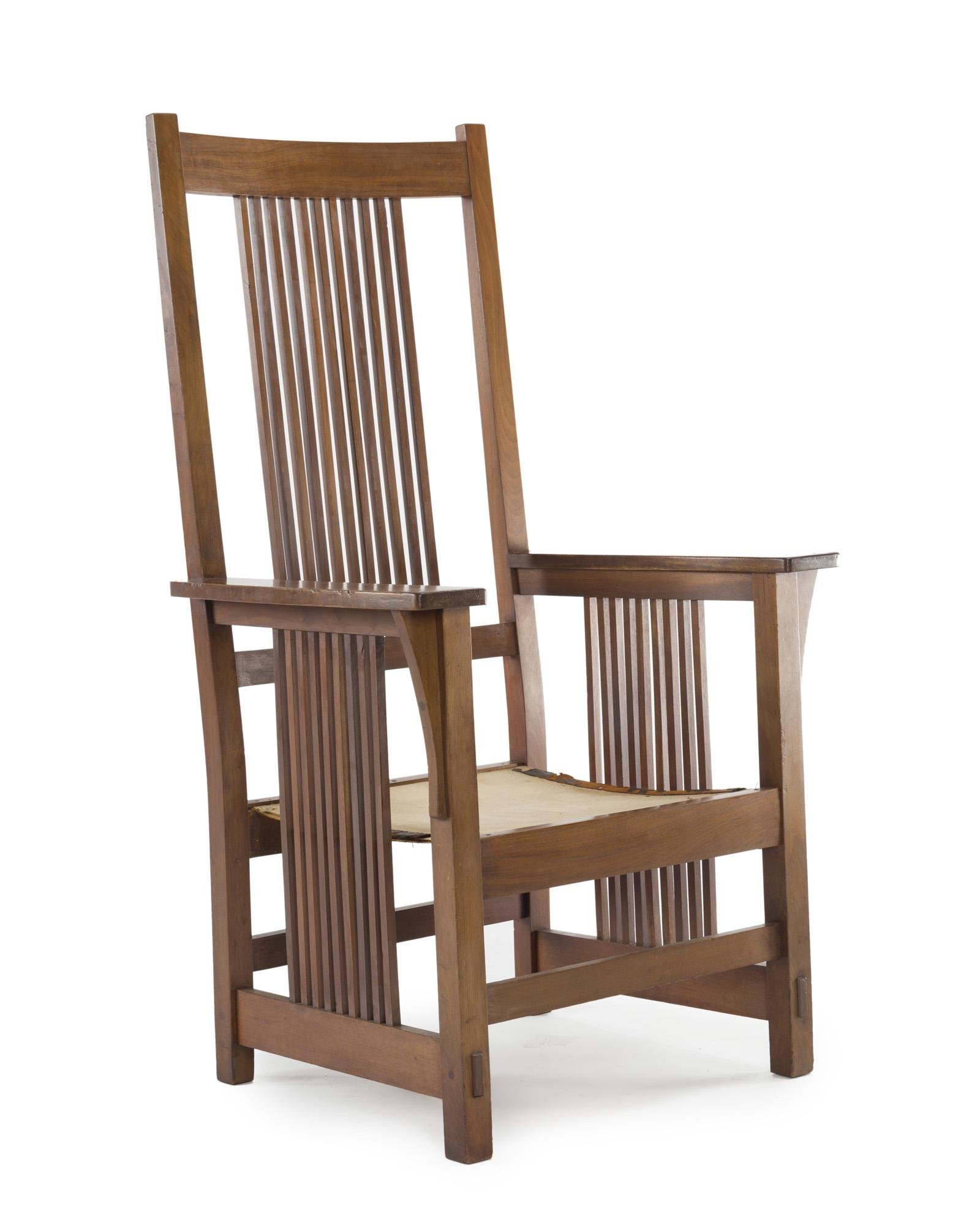 A Gustav Stickley oak spindle-arm chair, No. 384