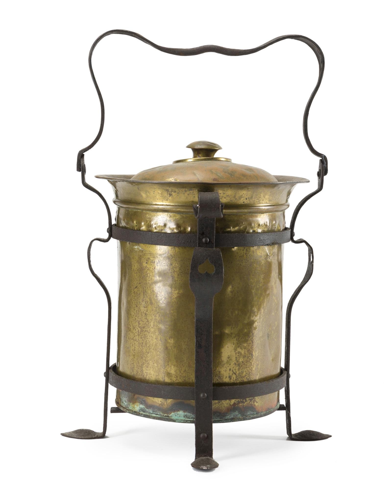 An English Arts & Crafts brass and iron coal bucket