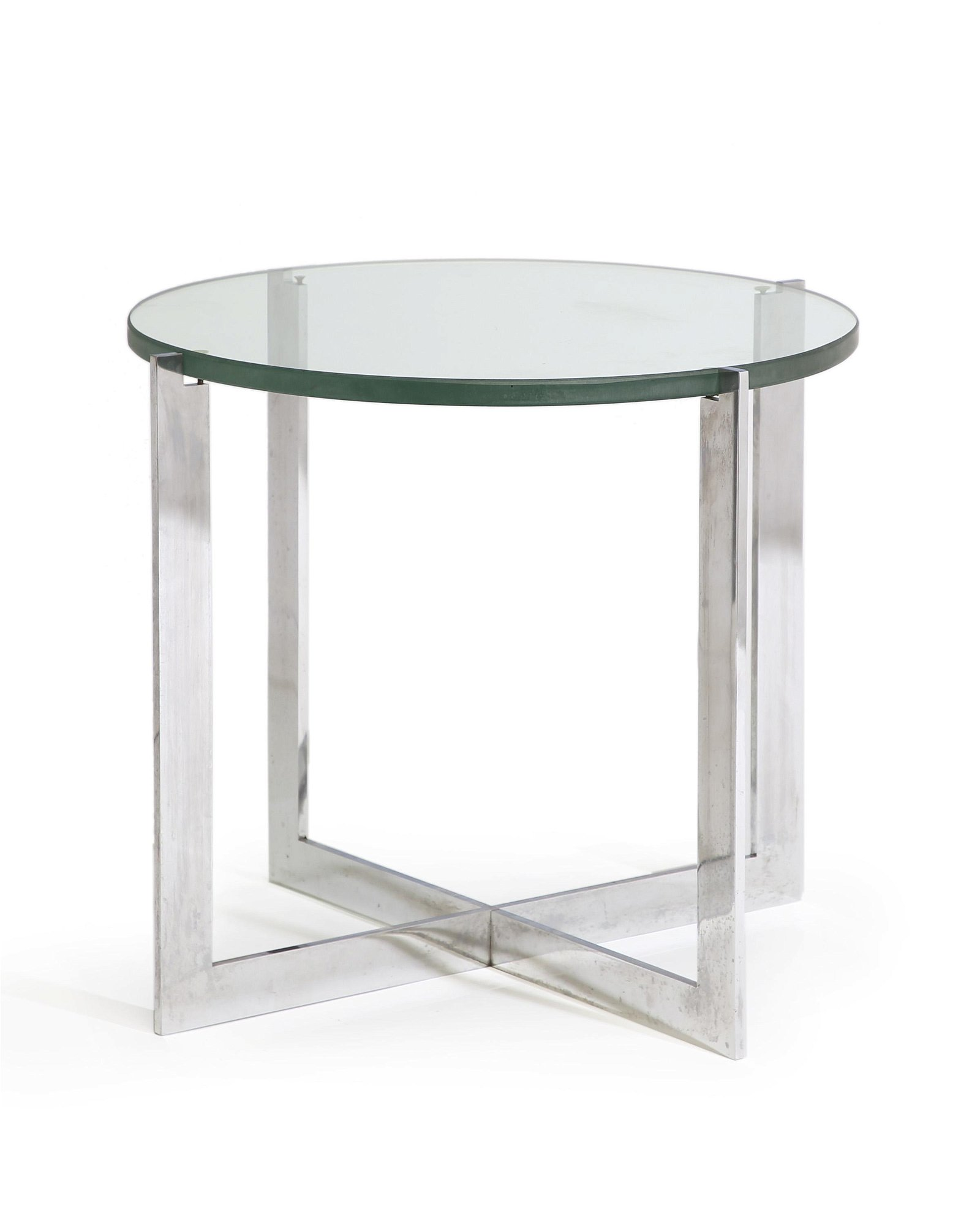 A glass and chrome circular side table