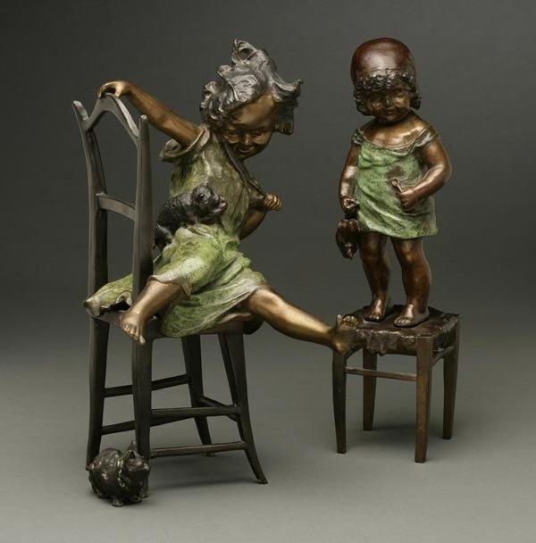 1008: After Juan Clara bronze young girls doll cats