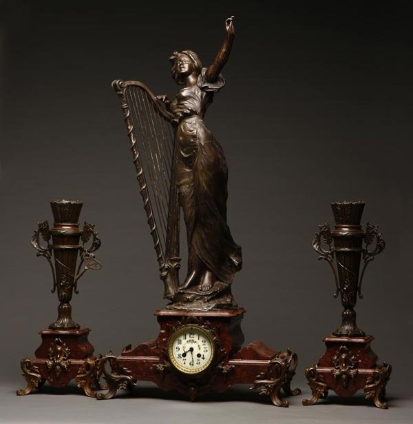 1013: A French spelter & Rouge Griotte clock garniture