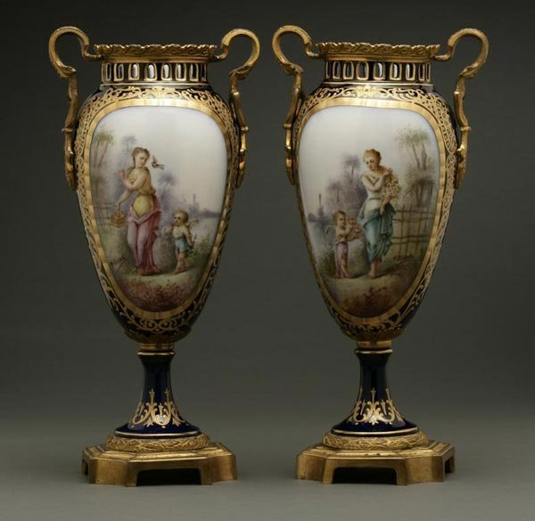 1015: A pair of Sevres style mounted porcelain vases