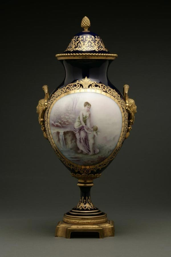 1016: A Sevres style mounted porcelain covered vase