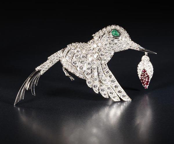 1022: A diamond, ruby and emerald hummingbird brooch