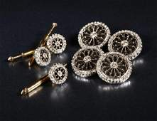 1217 An Art Deco gold diamond and onyx dress set
