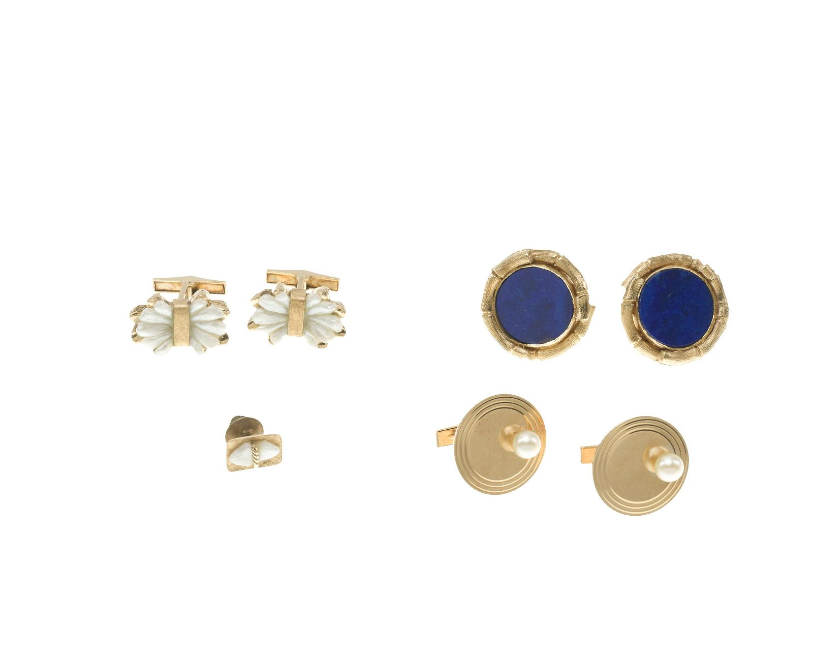 A group of gold and gemstone dress items