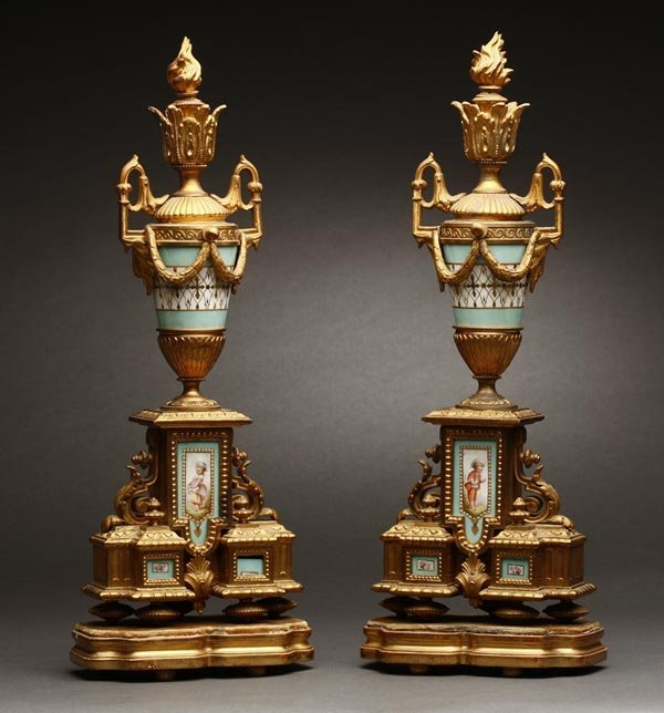1001: A pair of Louis XVI style gilt & porcelain urns